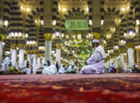 An Old Pilgrim praying inside Mosque