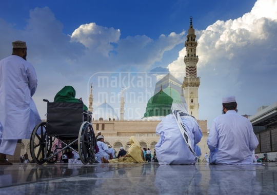 Pilgrims sitting near the Green Dome